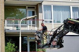 Hond gered van snikheet balkon