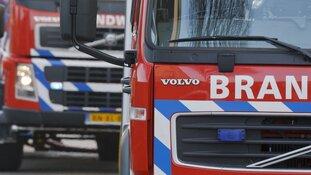Gezin op straat bij woningbrand in Zaandam